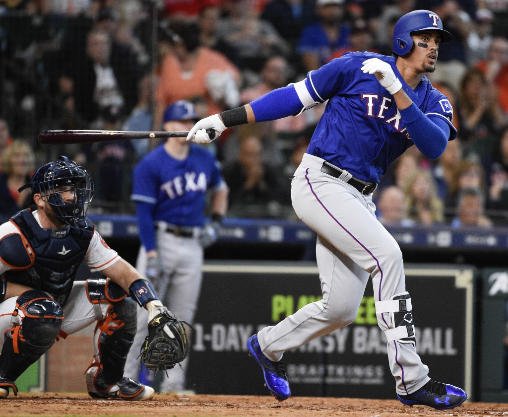 Texas Rangers' Ronald Guzman hits a game-tying home run off Houston Astros relief pitcher Brad Peacock during the eighth inning of a baseball game Sat