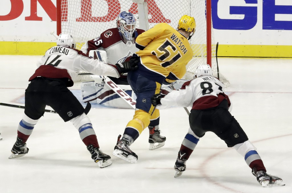 Nashville Predators left wing Austin Watson (51) scores a goal against Colorado Avalanche goaltender Jonathan Bernier (45) during the third period in