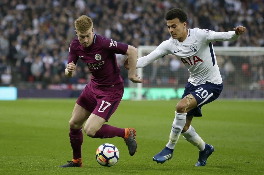 Manchester City's Kevin De Bruyne vies for the ball with Tottenham's Dele Alli, right, during the English Premier League soccer match between Tottenha