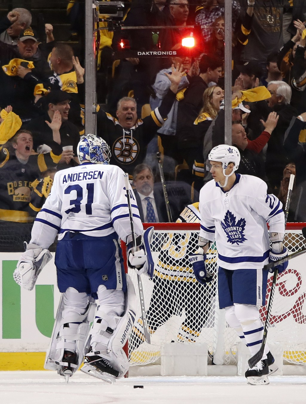Boston Bruins fans cheer behind Toronto Maple Leafs goaltender Frederik Andersen (31) and Nikita Zaitsev after the Boston Bruins scored during the fir
