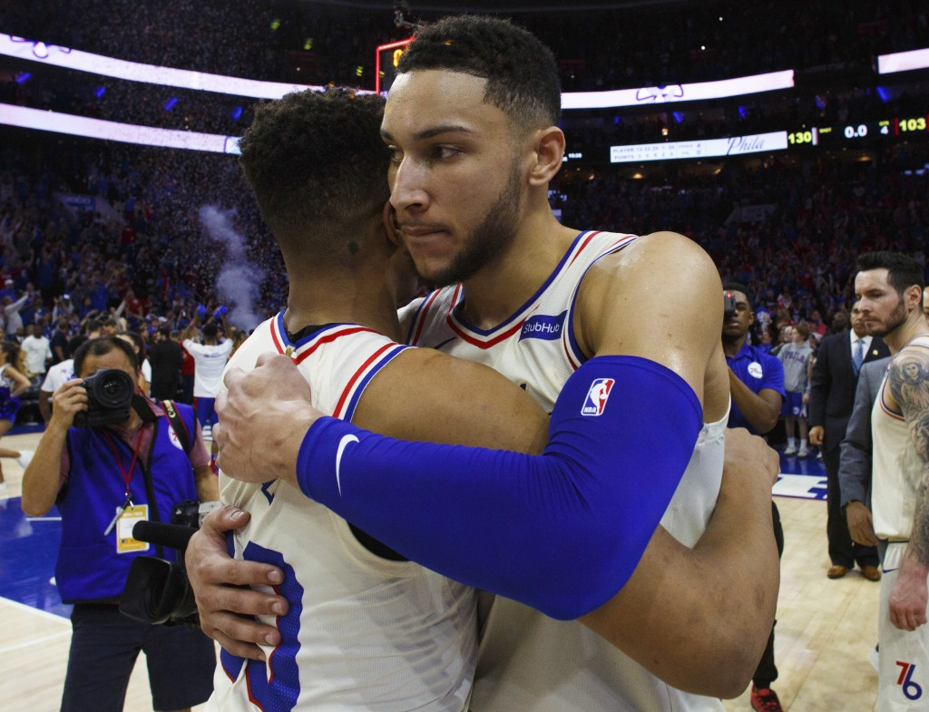 Philadelphia 76ers' Ben Simmons, right, gives Markelle Fultz a hug after Game 1 of the team's first-round NBA basketball playoff series against the Mi