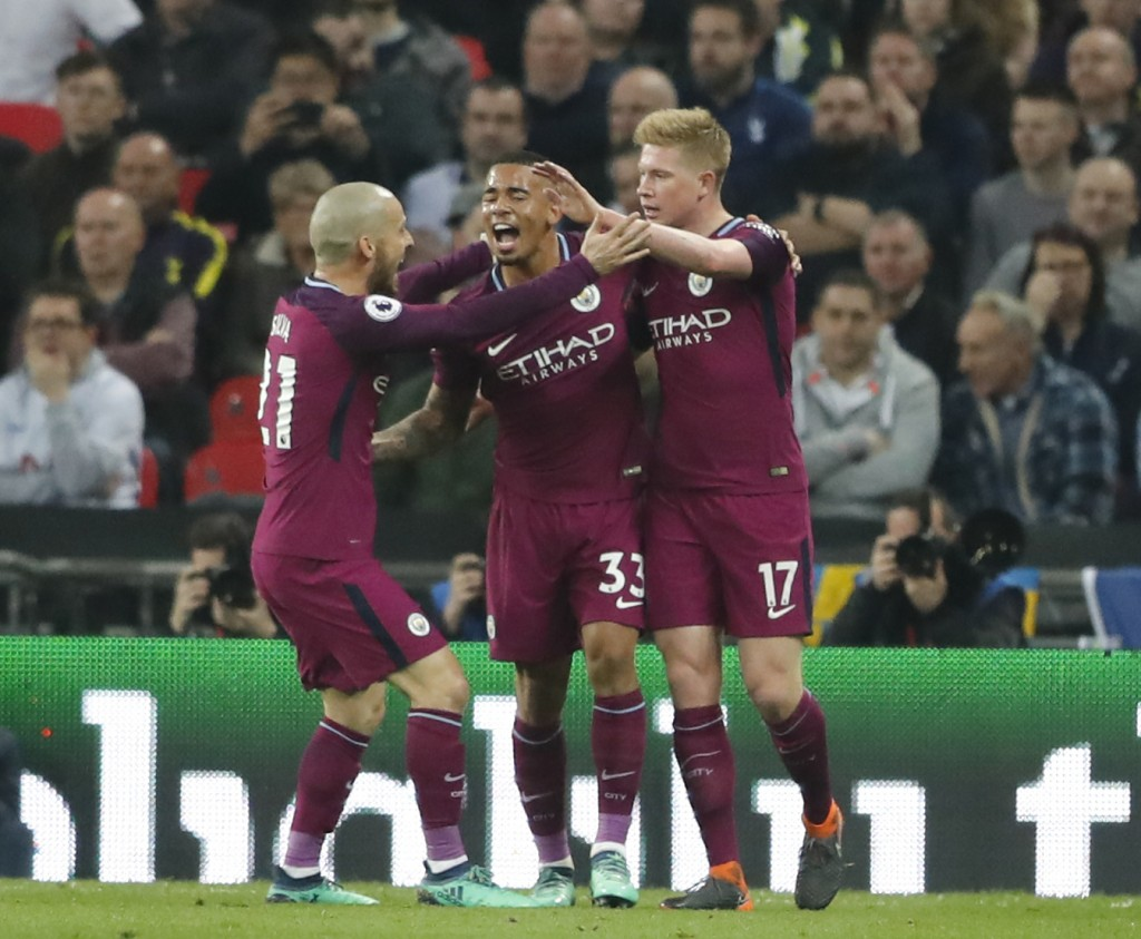 Manchester City's Gabriel Jesus celebrates with Kevin De Bruyne, right, and David Silva, after scoring the opening goal during the English Premier Lea...