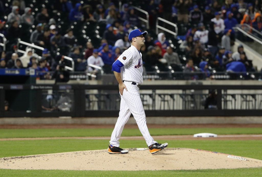 New York Mets starting pitcher Matt Harvey reacts after Milwaukee Brewers' Jett Bandy hit a home run during the fourth inning of a baseball game Satur