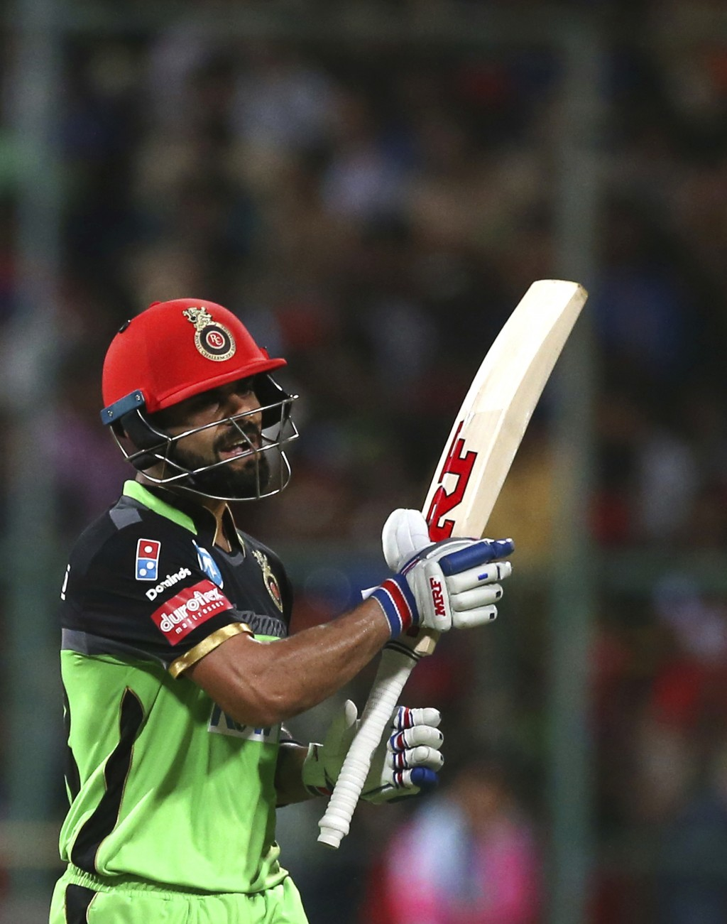 Royal Challengers Bangalore captain Virat Kohli reacts as he leaves the ground after losing his wicket during the VIVO IPL Twenty20 cricket match agai