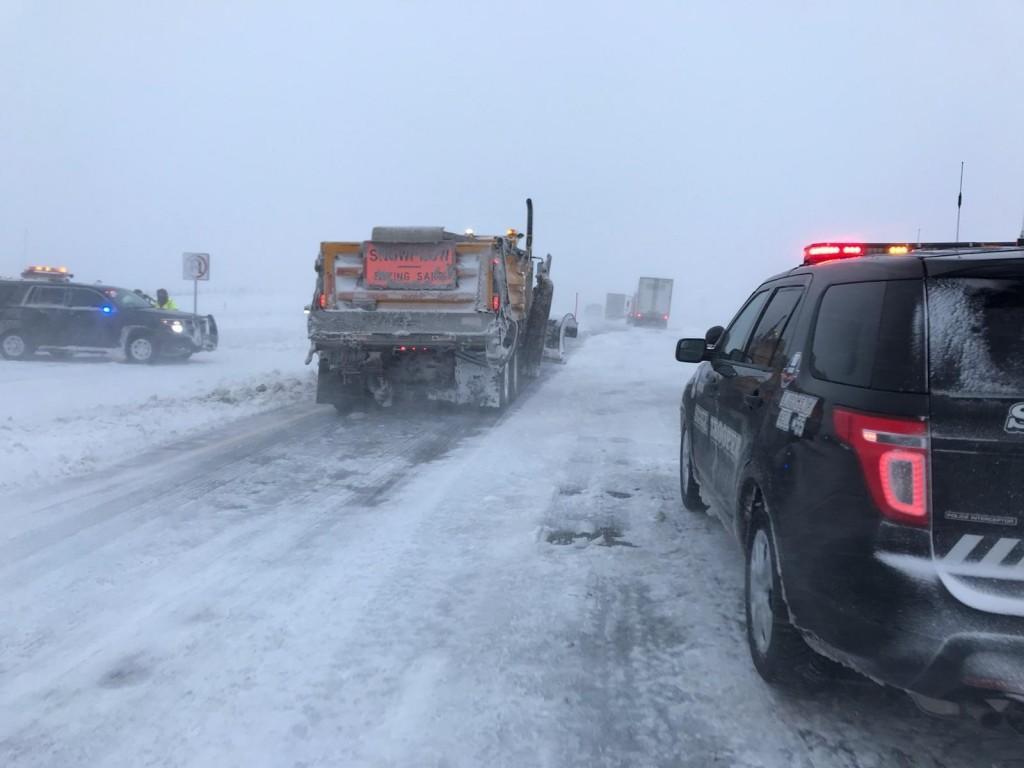 This photo provided by Nebraska State Patrol show stranded motorists on Interstate 80 near Sidney, Neb., Friday, April 13, 2018.  A potent spring stor