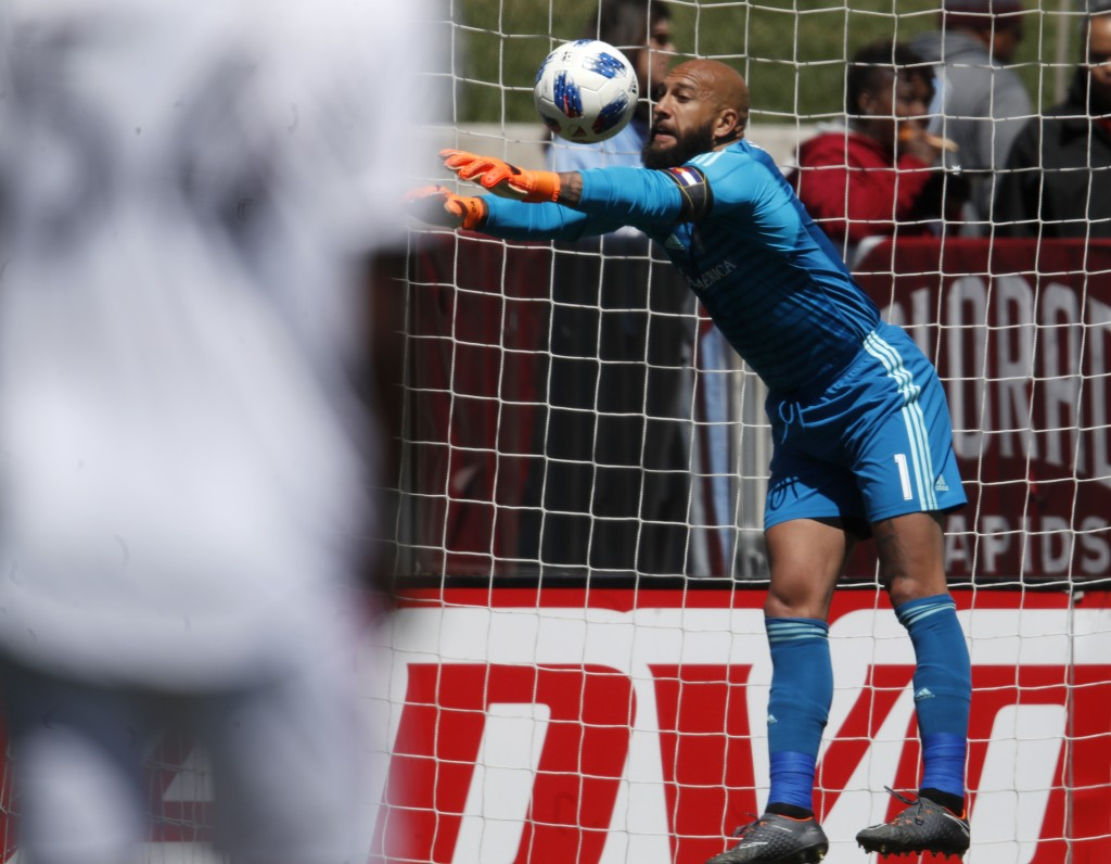 Colorado Rapids goalkeeper Tim Howard deflects a shot while facing Toronto FC in the first half of an MLS soccer match Saturday, April 14, 2018, in Co