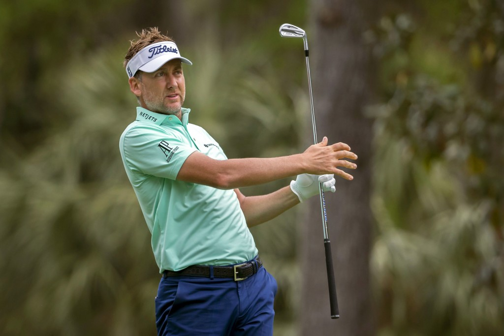 England's Ian Poulter watches his drive off the fourth tee during the final round of the RBC Heritage golf tournament in Hilton Head Island, S.C., Sun