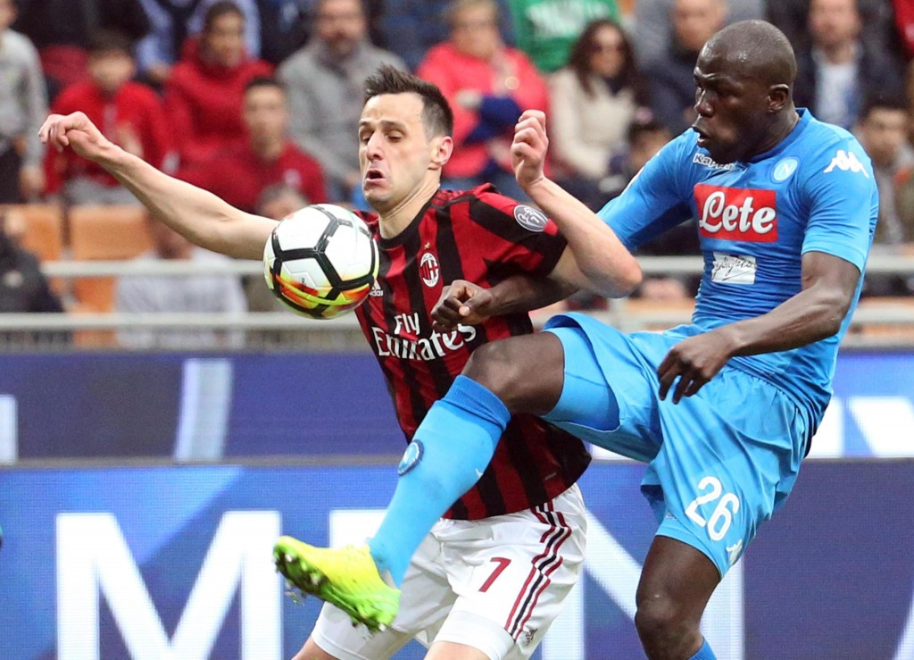 AC Milan's forward Nikola Kalinic and Napoli's defender Kalidou Koulibaly vie for the ball during the Serie A soccer match between Napoli and AC Milan