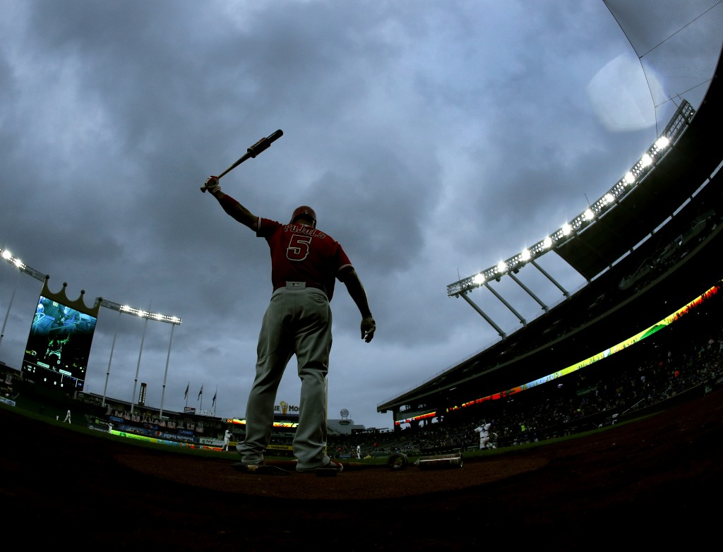 Los Angeles Angels' Albert Pujols warms up on deck during the second inning of a baseball game against the Kansas City Royals, Saturday, April 14, 201