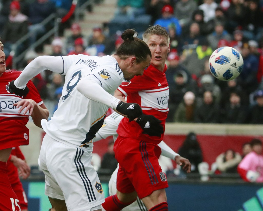 Chicago Fire midfielder Bastian Schweinsteiger (31), watches as Los Angeles Galaxy forward Zlatan Ibrahimovic (9), scores a goal during the first half