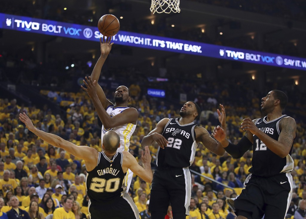 Golden State Warriors' Kevin Durant, second from left, shoots over San Antonio Spurs' Manu Ginobili (20), Rudy Gay (22) and LaMarcus Aldridge (12) dur