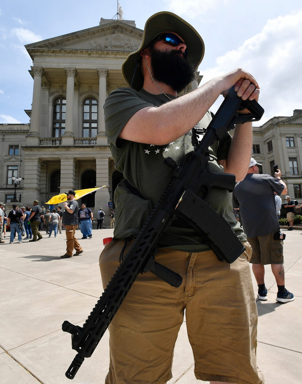Andrew Norris, of Monroe, Ga.,participates in a gun-rights rally at the state capitol, Saturday, April 14, 2018, in Atlanta.  About 40 gun rights supp