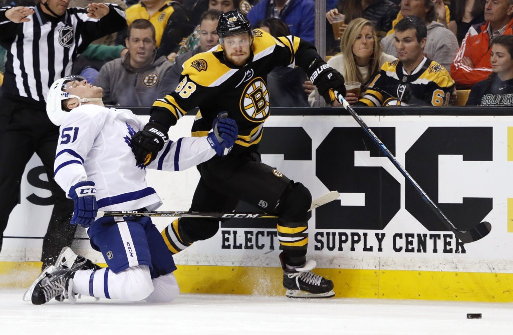 Boston Bruins' David Pastrnak carries the puck past Toronto Maple Leafs' Jake Gardiner during the second period of Game 2 of an NHL hockey first-round