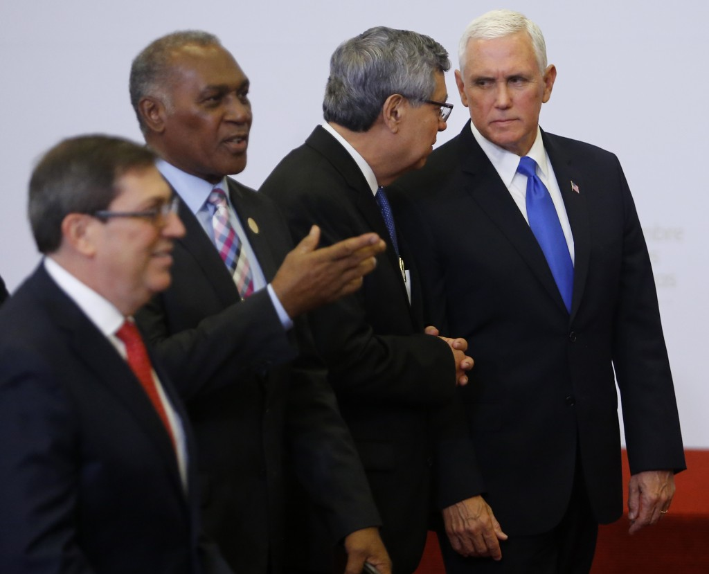 U.S. Vice President Mike Pence, right, speaks with Guatemala's Vice President Jafeth Cabrera after the official photo at the Summit of the Americas in
