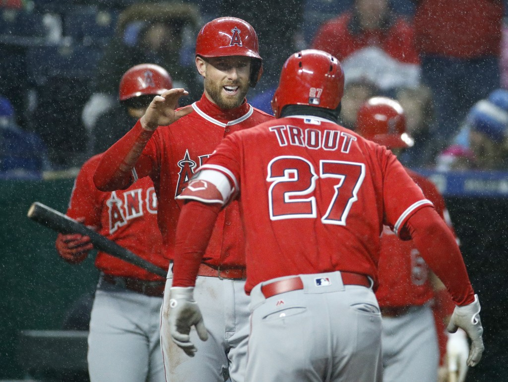 Los Angeles Angels' Mike Trout (27) celebrates with Zack Cozart after hitting a two-run home run during the fifth inning of a baseball game against th