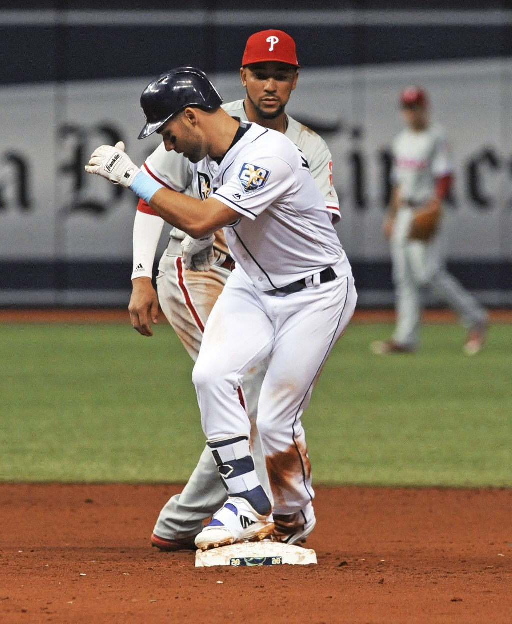 Philadelphia Phillies shortstop J.P. C Crawford, right, eyes Tampa Bay Rays' Kevin Kiermaier who steps on second base with a double off Phillies start