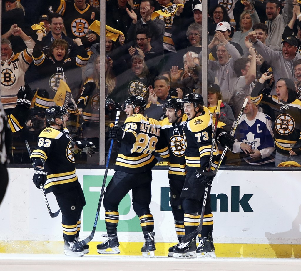 Boston Bruins' Brad Marchand, David Pastrnak, Patrice Bergeron and Charlie McAvoy, from left, celebrate after Pastrnak scored against the Toronto Mapl