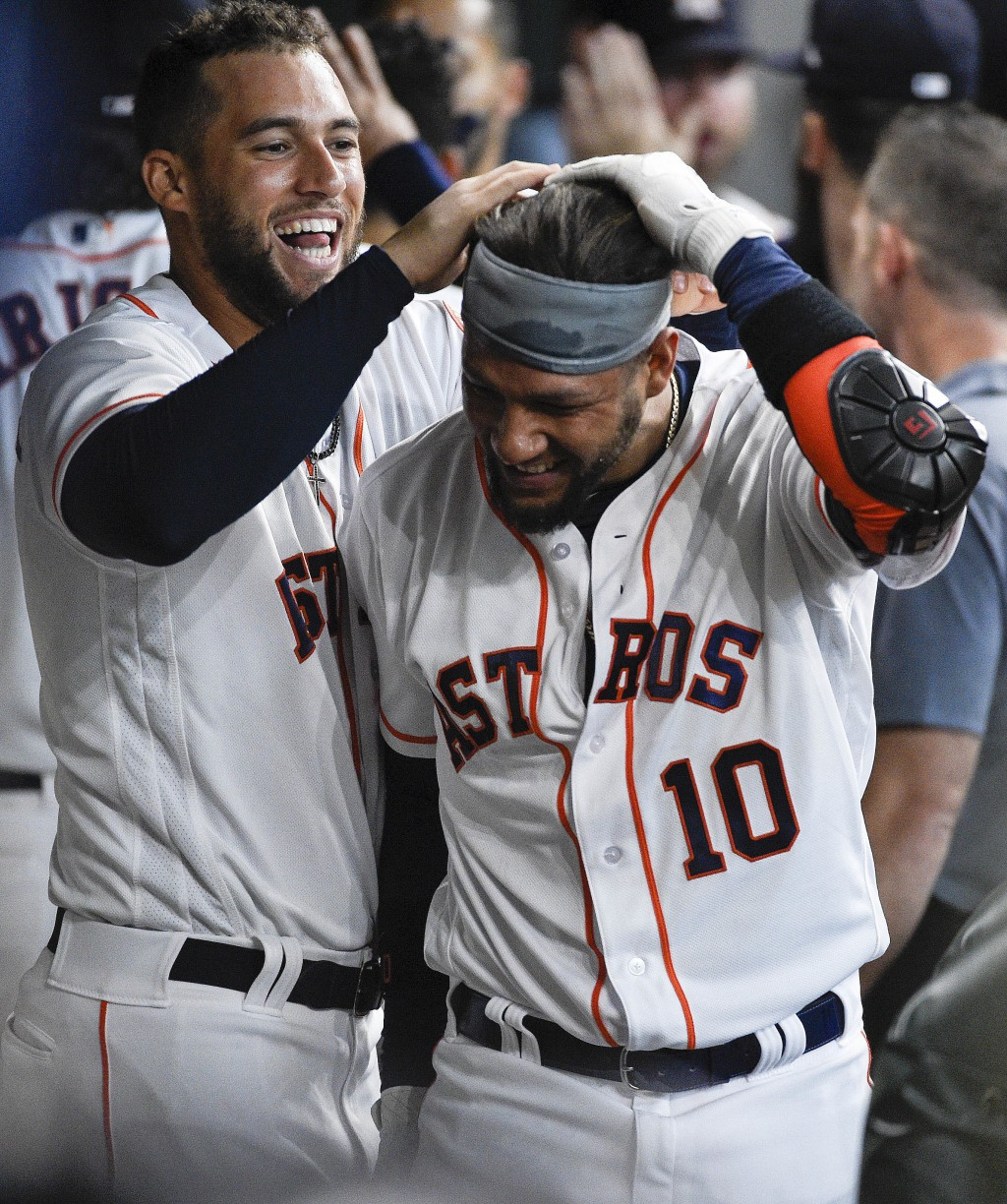 Houston Astros' Yuli Gurriel (10) celebrates his three-run home run off Texas Rangers starting pitcher Mike Minor with George Springer during the four