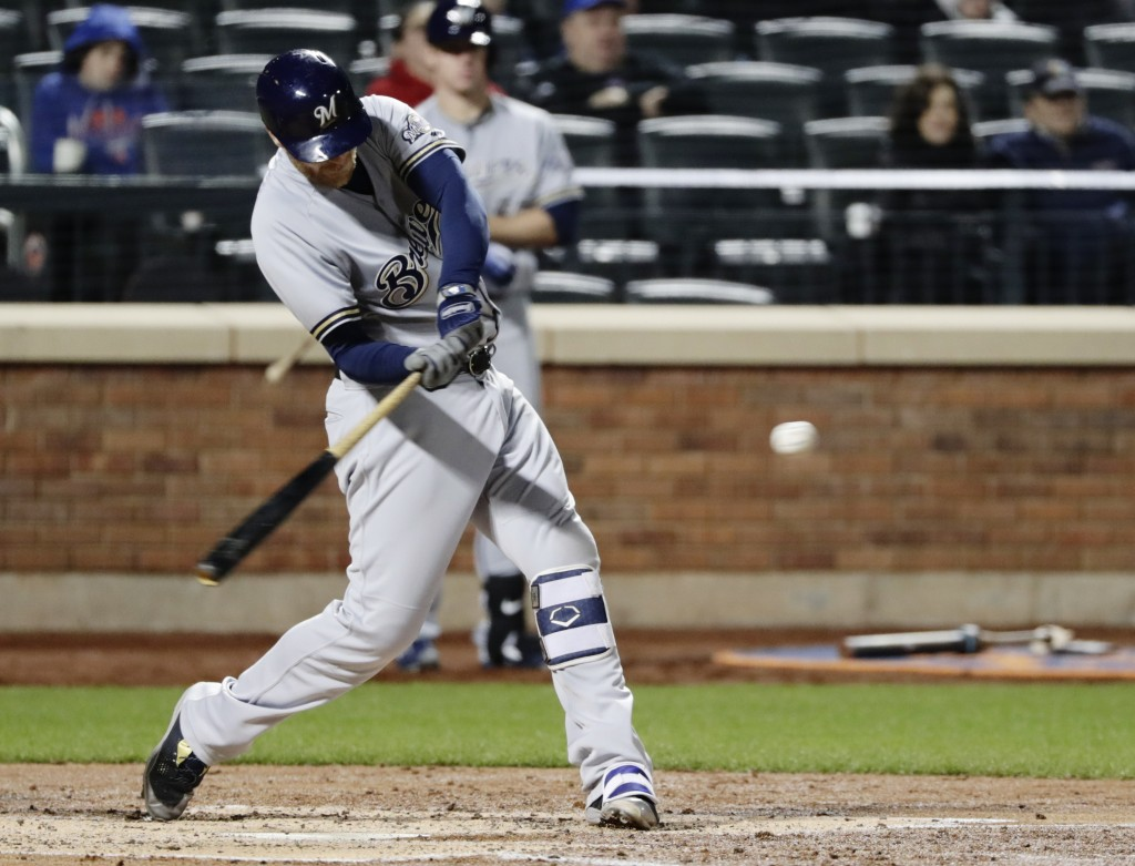 Milwaukee Brewers' Jett Bandy (47) hits a home run during the fourth inning of a baseball game against the New York Mets, Saturday, April 14, 2018, in