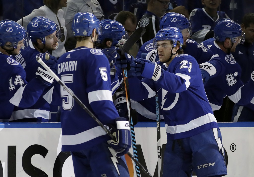 Tampa Bay Lightning center Brayden Point (21) celebrates his goal against the New Jersey Devils with teammates, including defenseman Dan Girardi (5),