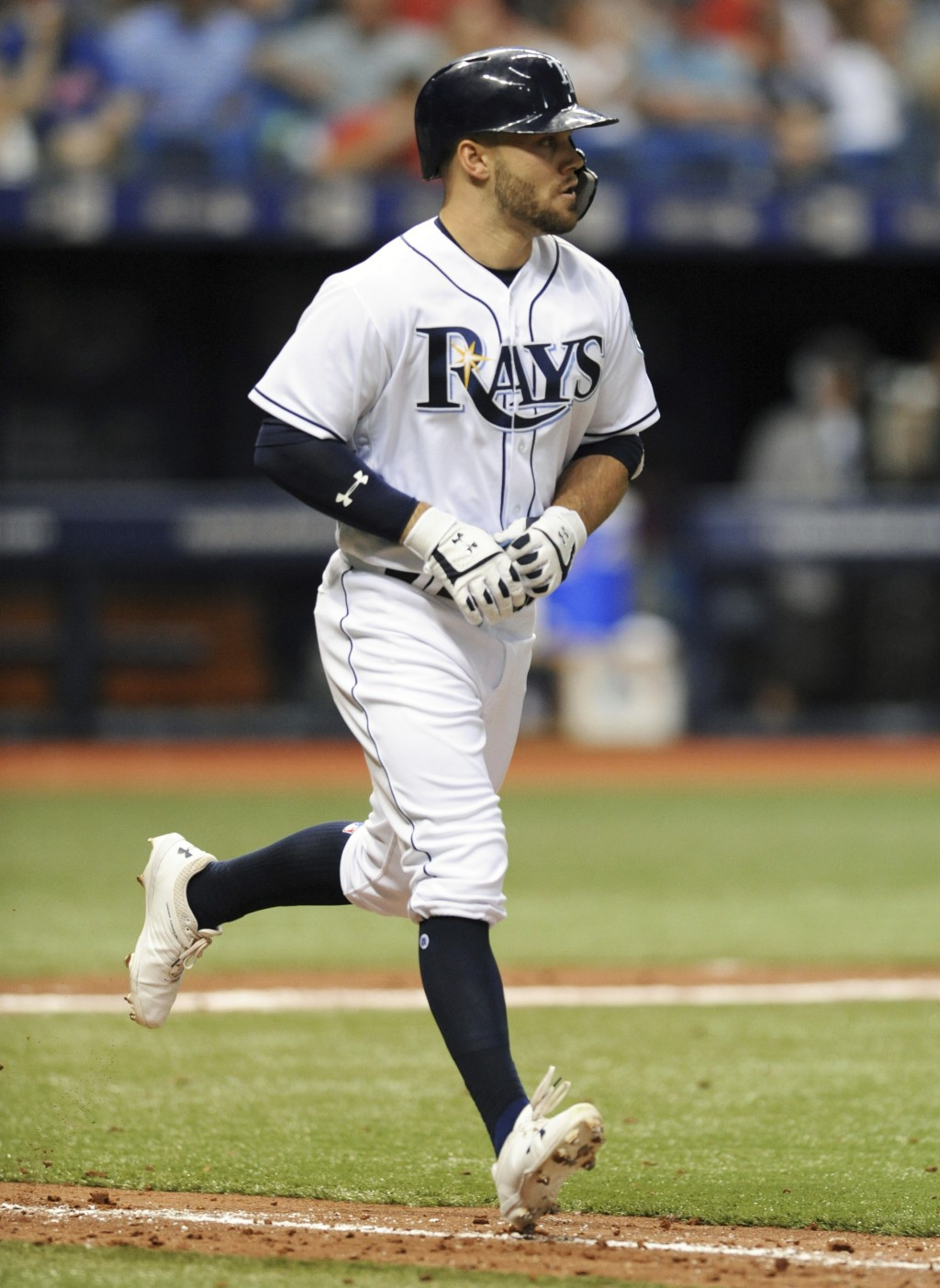 Tampa Bay Rays' Johnny Field, making his major league debut, jogs toward first base after walking against Philadelphia Phillies starter Jake Arrieta d