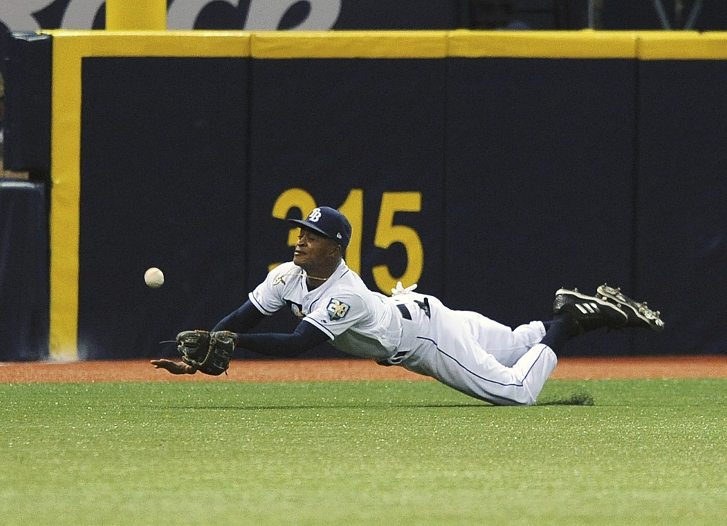 Tampa Bay Rays left fielder Mallex Smith robs Philadelphia Phillies' J.P. Crawford of a base hit during the fifth inning of a baseball game Saturday,