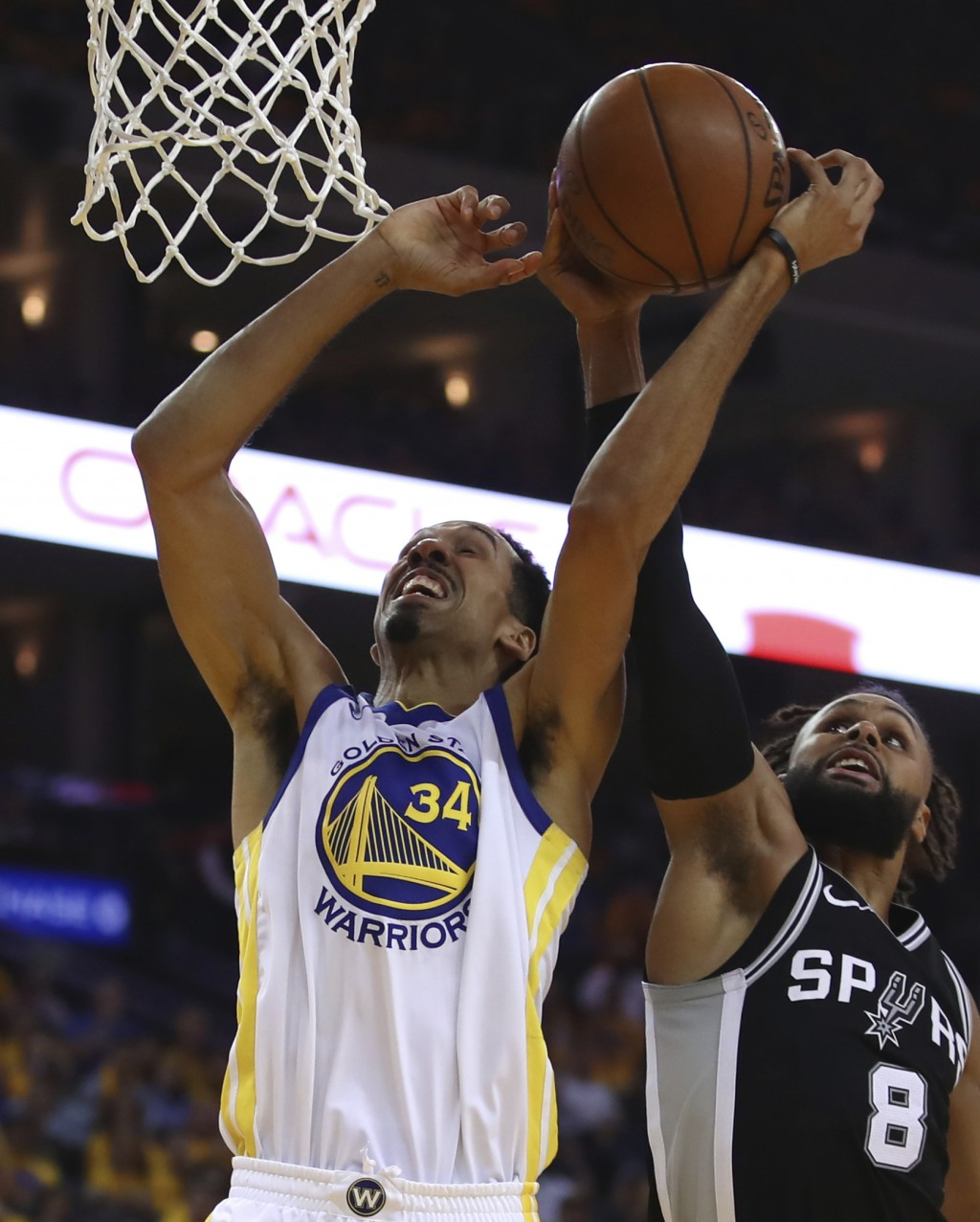 San Antonio Spurs' Patty Mills, right, blocks the shot of Golden State Warriors' Shaun Livingston (34) during the first half in Game 1 of a first-roun