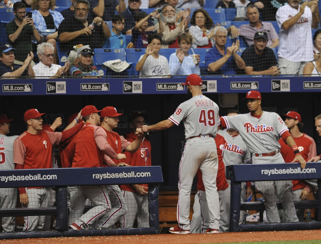 Philadelphia Phillies greet starting pitcher Jake Arrieta at the dugout as he leaves the baseball game against the Tampa Bay Rays during the seventh i