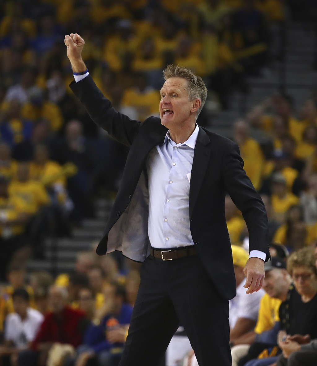 Golden State Warriors coach Steve Kerr gestures during the first half in Game 1 of a first-round NBA basketball playoff series against the San Antonio