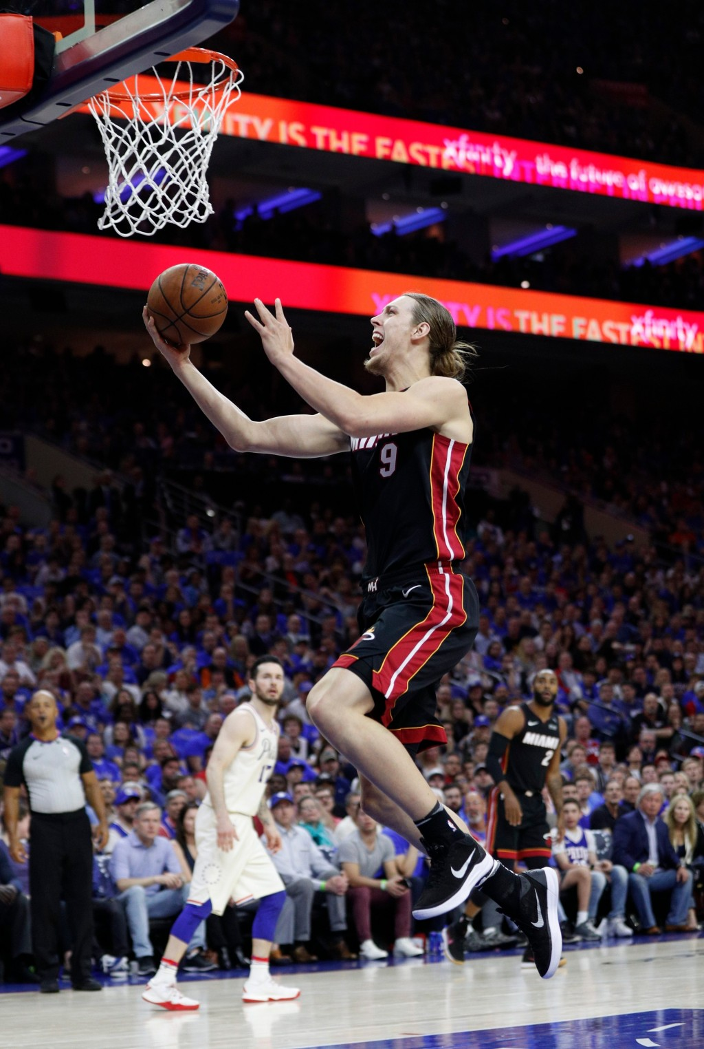 Miami Heat's Kelly Olynyk goes up for the shot during the first half in Game 1 of a first-round NBA basketball playoff series against the Philadelphia