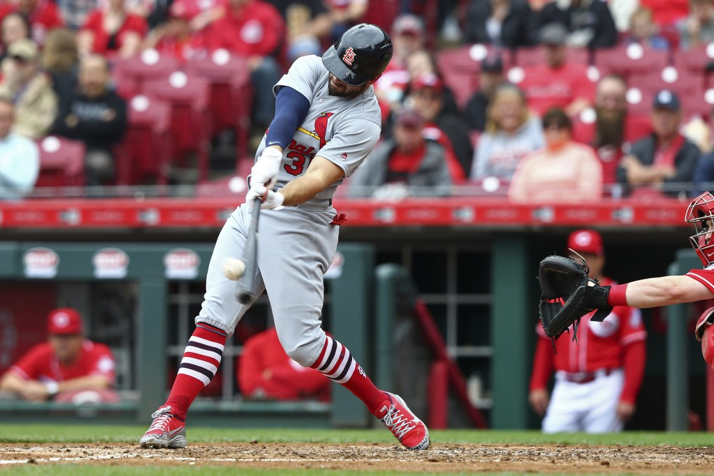 St. Louis Cardinals' Greg Garcia hits a home run in the fourth inning of a baseball game against the Cincinnati Reds, Saturday, April 14, 2018, in Cin