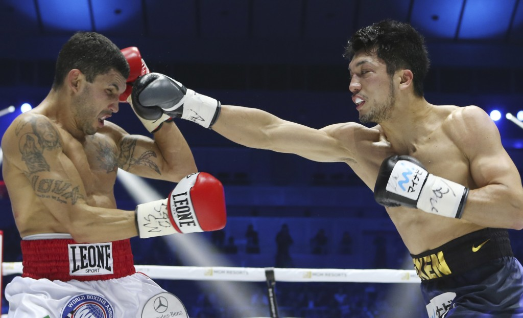 WBA middleweight champion Ryota Murata, right, delivers his right to Italian challenger Emanuele Blandamura during their WBA middleweight title bout i