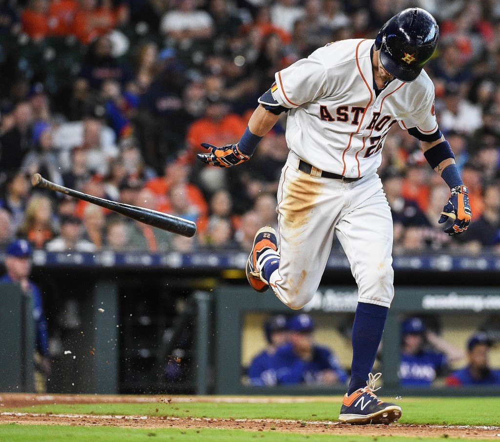Houston Astros' Josh Reddick throws his bat after grounding out to end the eighth inning of a baseball game against the Texas Rangers, Saturday, April