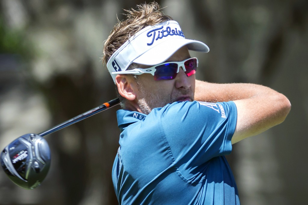 Ian Poulter, of England, watches his shot off the second tee during the third round of the RBC Heritage golf tournament in Hilton Head Island, S.C., S