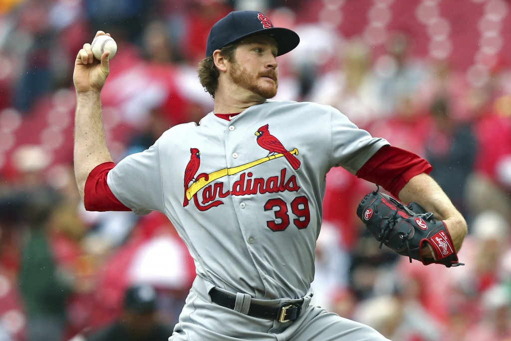 St. Louis Cardinals' starting pitcher Miles Mikolas throws in the first inning of a baseball game against the Cincinnati Reds, Saturday, April 14, 201