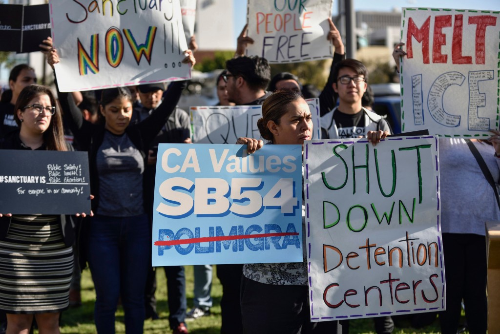 FILE - In this March 27, 2018, file photo, a group of sanctuary state supporters gather outside the Orange County Board of Supervisors meeting in Sant