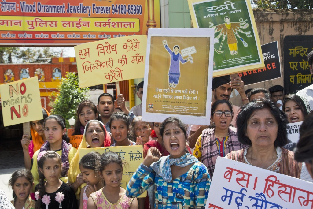Indian women shout slogans during a protest gathering organised by a non governmental organization to condemn violence against women in Dharmsala, Ind...