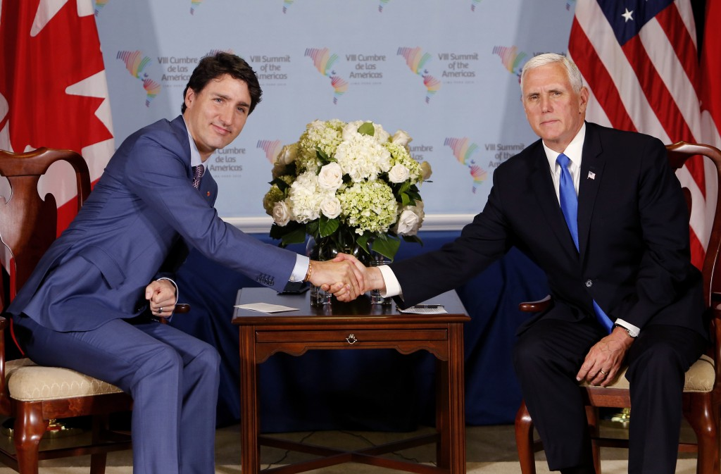 U.S. Vice President Mike Pence, right, shakes hands with Canada's Prime Minister Justin Trudeau after a bilateral meeting at the Summit of the America