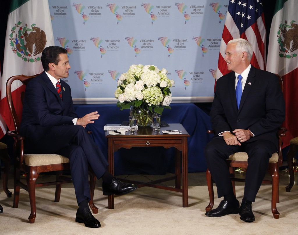 U.S. Vice President Mike Pence, right, meets Mexico's President Enrique Pena Nieto during a bilateral meeting at the Summit of the Americas in Lima, P