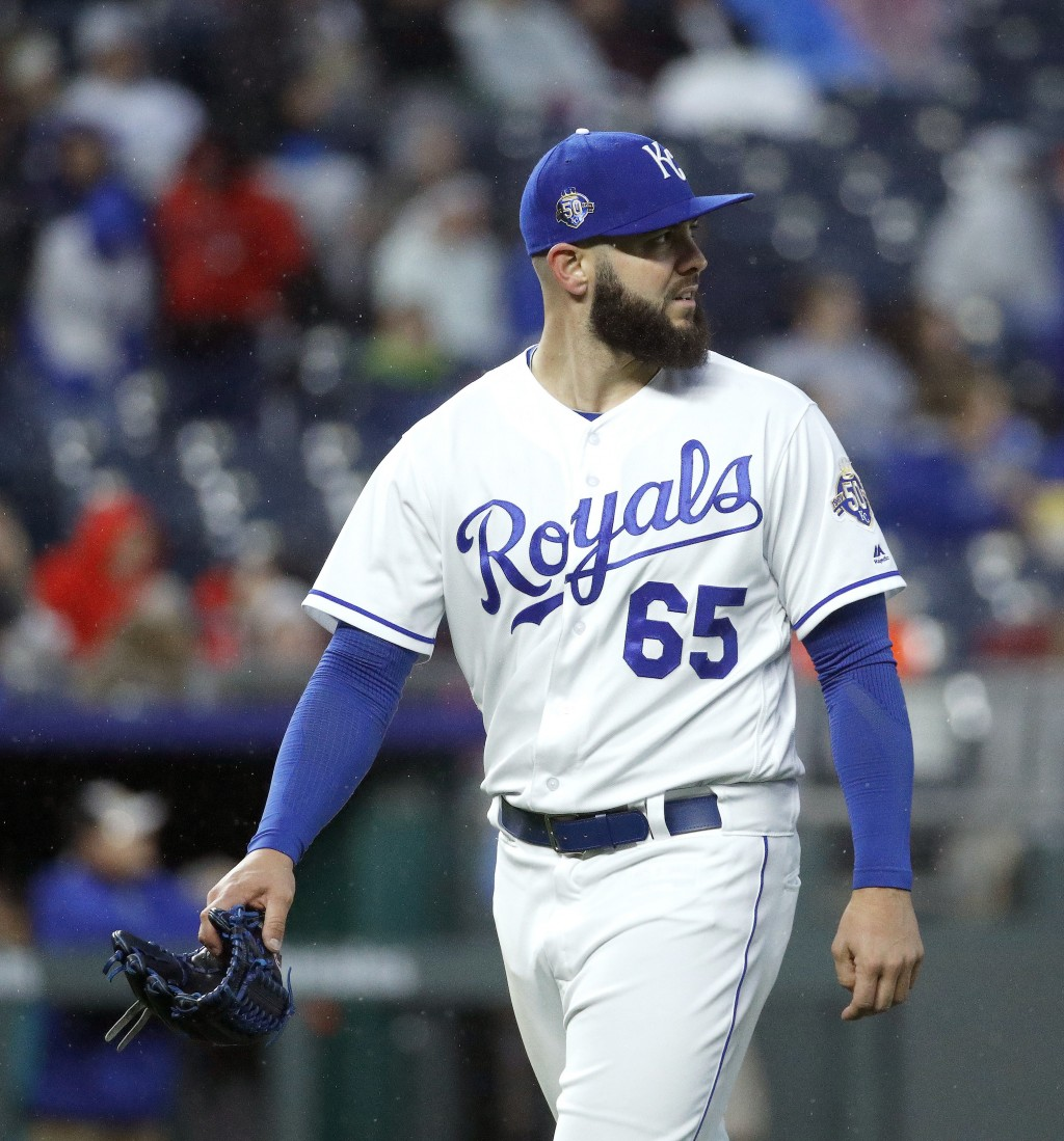 Kansas City Royals starting pitcher Jakob Junis walks to the dugout after coming out of a baseball game during the fifth inning against the Los Angele