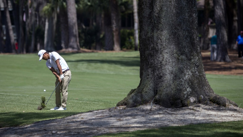 Satoshi Kodaira, of Japan, hits out of the rough of the second fairway during the third round of the RBC Heritage golf tournament in Hilton Head Islan