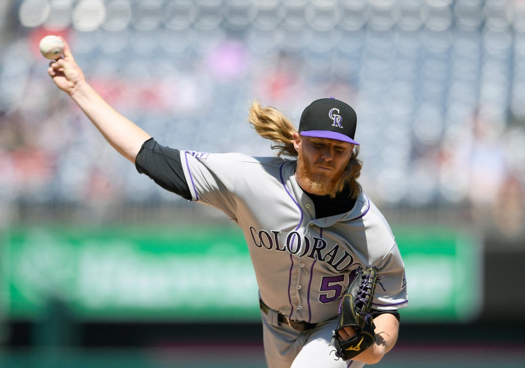 Colorado Rockies starting pitcher Jon Gray delivers a pitch during the first inning of a baseball game against the Washington Nationals, Saturday, Apr...