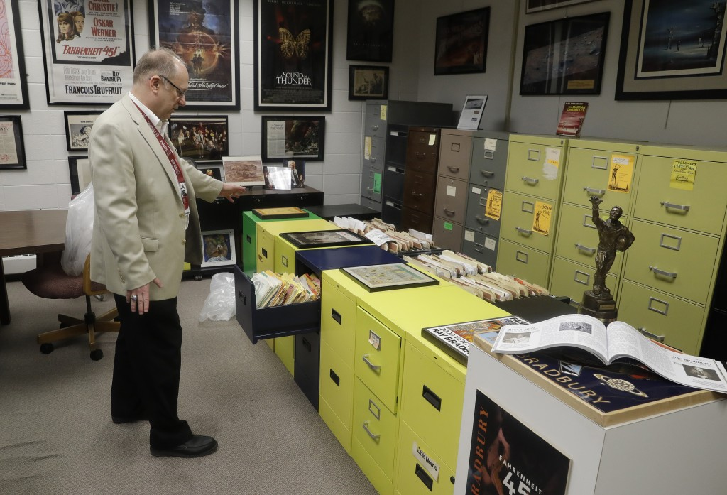 In this Thursday, April 12, 2018, photo, Center for Ray Bradbury Studies director Jonathan Eller talks about the archival area of the Center for Ray B