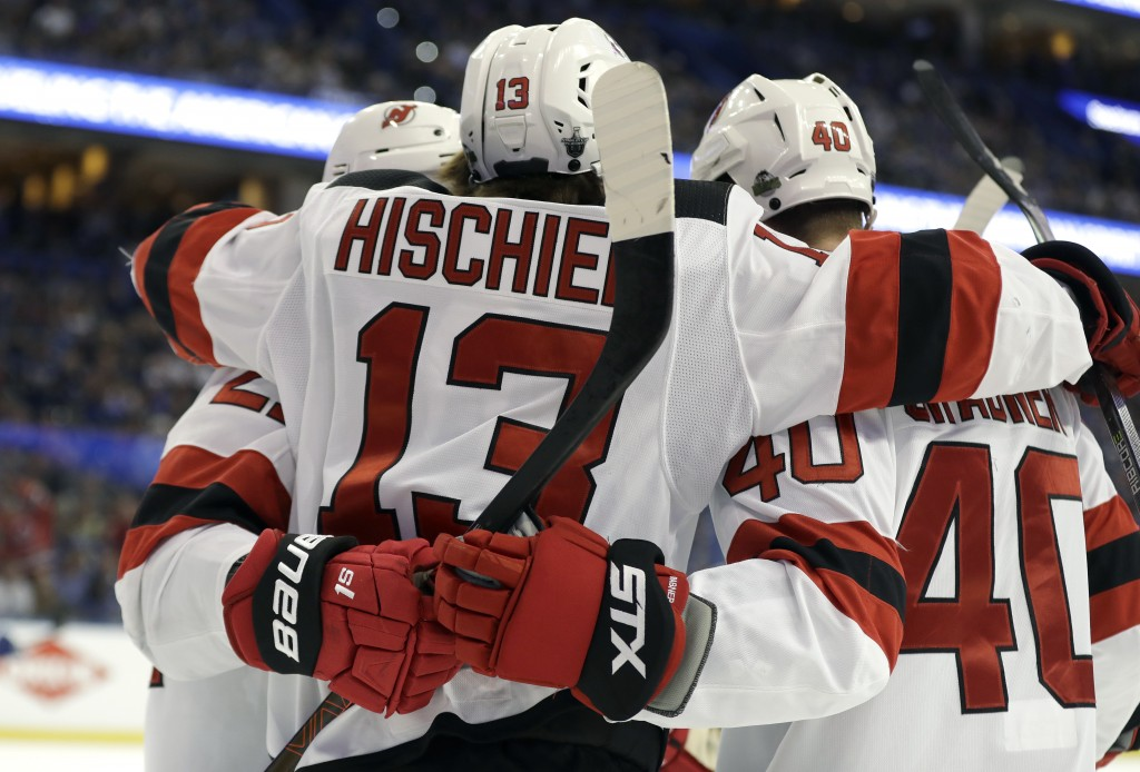 New Jersey Devils center Nico Hischier (13) celebrates his goal against the Tampa Bay Lightning with right wing Michael Grabner (40) during the first