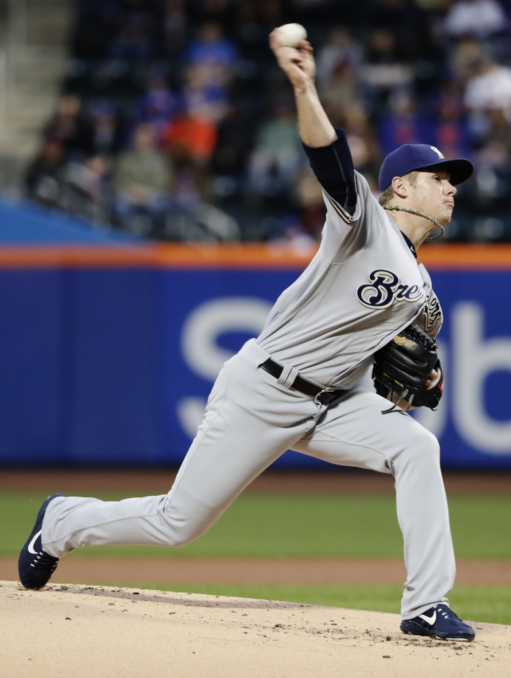 Milwaukee Brewers' Chase Anderson delivers a pitch during the first inning of a baseball game against the New York Mets Saturday, April 14, 2018, in N