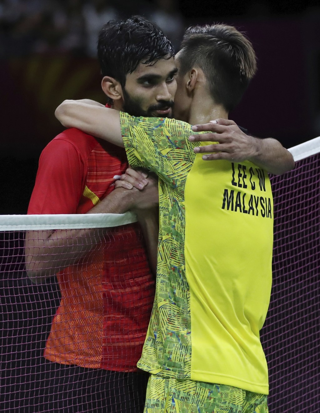 Malaysia's Lee Chong Wei hugs India's Srikanth Kidambi after their men's singles badminton final match at Carrara Sports Hall during the Commonwealth