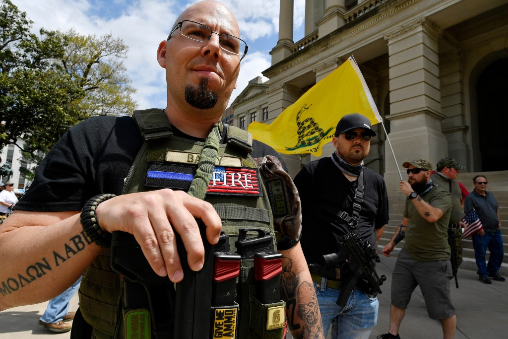 Shaun Baby, of Cartersville, Ga., participates in a gun-rights rally at the state capitol, Saturday, April 14, 2018, in Atlanta.  About 40 gun rights
