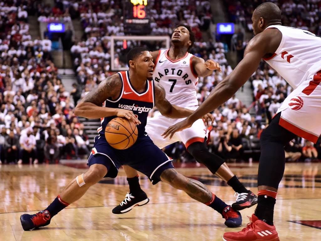 Washington Wizards guard Bradley Beal (3) protects the ball from Toronto Raptors guard Kyle Lowry (7) during the second half of Game 1 of an NBA baske