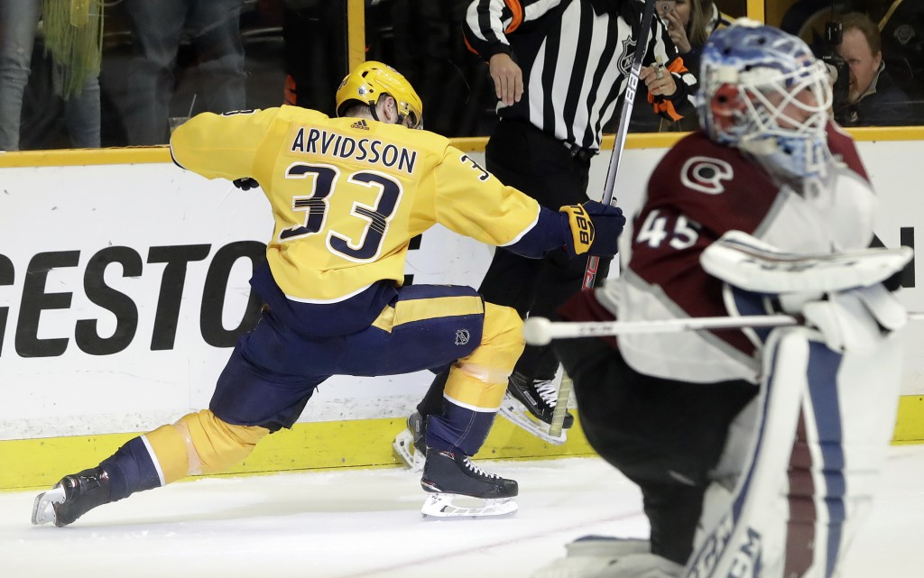 Nashville Predators left wing Viktor Arvidsson (33), of Sweden, celebrates after scoring a goal against Colorado Avalanche goaltender Jonathan Bernier