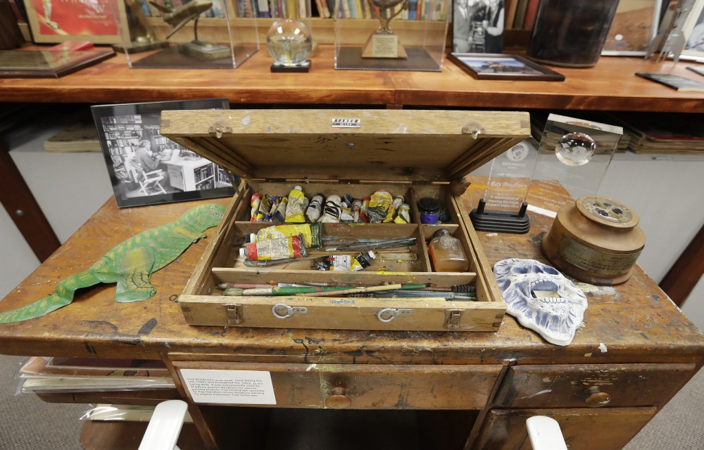 In this Thursday, April 12, 2018, photo, IUPUI's Center for Ray Bradbury Studies preserves the author's oldest surviving desk that is pictured, in Ind